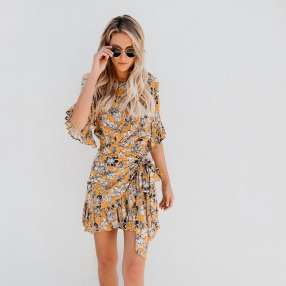 vici Dresses & Skirts - Vici collection yellow floral wrap dress